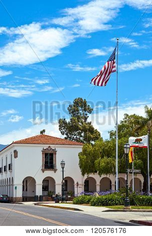 Santa Barbara, U.S.A. - June 1, 2011: A traditional house .in the country center with flags in the foreground.
