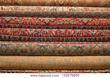 Rolled-up Turkish Or Persian Carpets In A Variety Of Colors In A Carpet Store