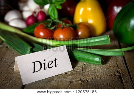 Different Healthy Vegetables On A Old Wooden Table, Card With Word Diet