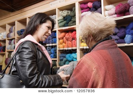 Two women shopping for yarn