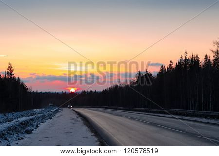 Spring Road With Cars At Sunset