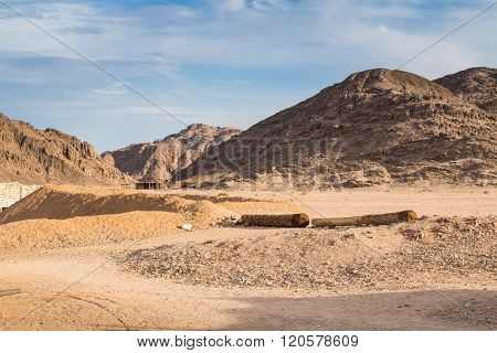 Mountains Of Egyptian Desert And Bedouin Village