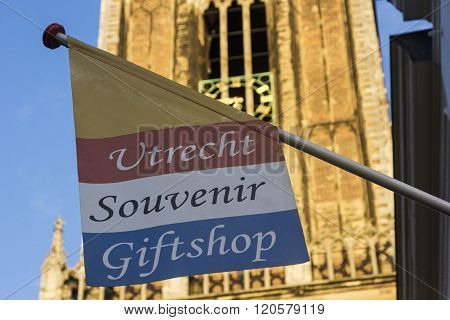 UTRECHT, UTRECHT, NETHERLANDS - OCTOBER 22, 2014: Gift shop in Utrecht in Holland with St. Martin's Cathedral in the background