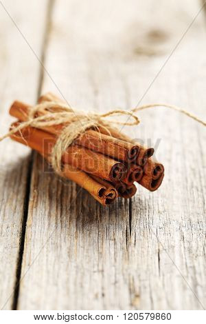 Cinnamon On A Grey Wooden Background