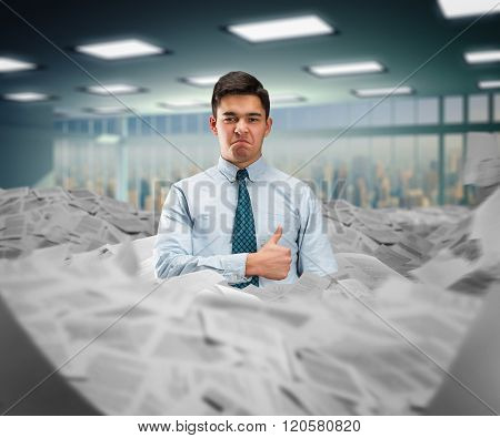 Businessman in the heap of papers