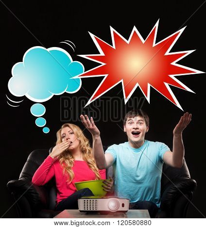 Couple watching a sport event on a laser projector. Husband being emotional while wife being bored. Comics concept.