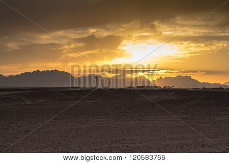 Sunset Behind The Mountains In The Desert, Egypt