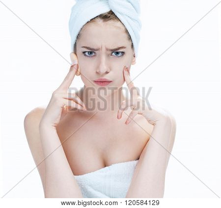 Scowling young girl youth and skin care concept.