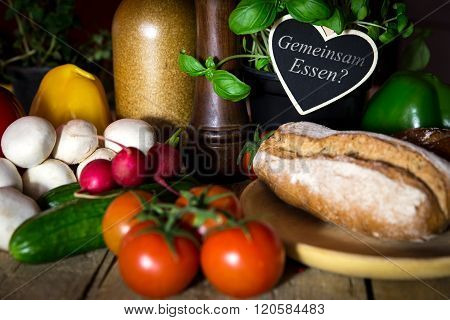 A Lots Of Vegetables And  Bread On A Wooden Table, Heart With Text Gemeinsam Essen