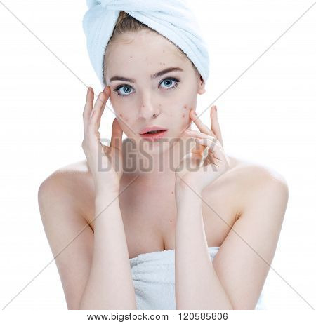 Teenager checking her face for pimple.