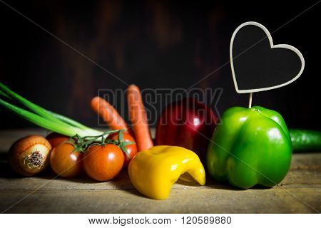 Vegetables On A Old Wooden Table With A Heart With Copyspace