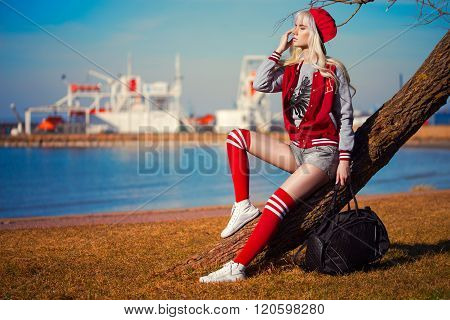 Pretty Blonde Young Woman In Posing Outdoors