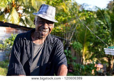 Garifuna man smiles into the camera in Livingston, Guatemala