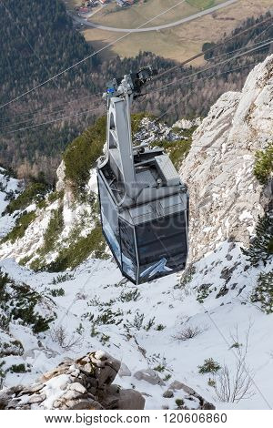 cable railway on its way up the mountain in winter