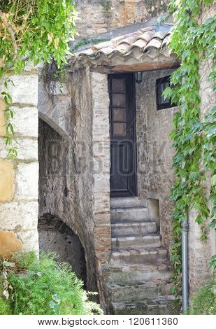 Traditional old house exterior in historic town in south of France