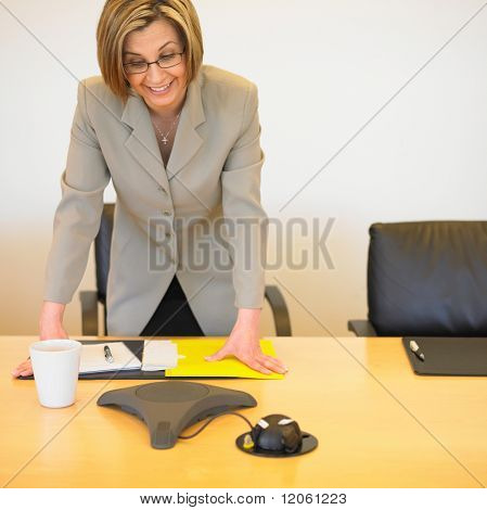 Businesswoman standing at desk