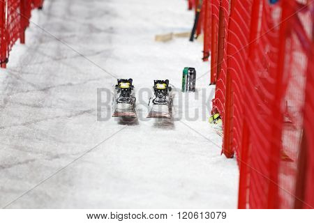 STOCKHOLM SWEDEN - FEB 23 2016: Pair of slalom skis and red fences front view at the Audis FIS Alpine Ski World Cup city event February 23 2016 Stockholm Sweden