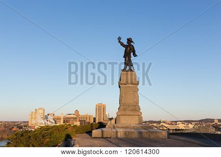 Statue of Jacques Cartier against a blue sky in spring