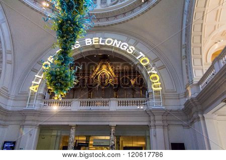 LONDON UNITED KINGDOM - JUNE 6 2015: Interior of the Victoria and Albert Museum lobby with Dale Chihuly glass chandelier. V&A Museum is the world's largest museum of decorative arts and design.