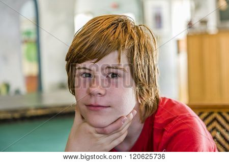 Young Teenage Boy With Long Red Hair