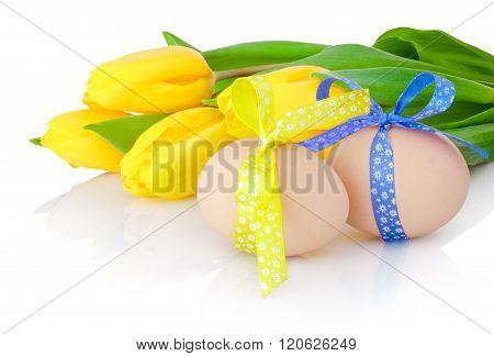 Two Easter Egg And Yellow Tulip Flowers Isolated On White Background