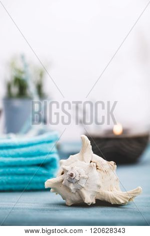 Spa and wellness setting with flowers candles and towel. Blue dayspa nature set with copyspace