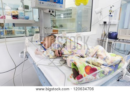 Baby In Clinic Bed
