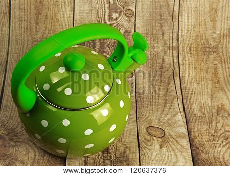 Traditional Kettle With Whistle On A Wooden Countertop