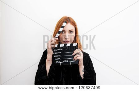 Young Redhead Woman Portrait With Black Movie Clapper Board