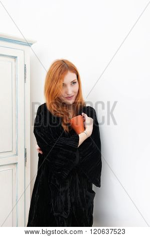 Young Redhead Woman Smiling With Orange Mug