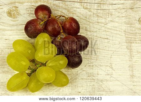 Fresh Grapes On Old Wooden Countertop