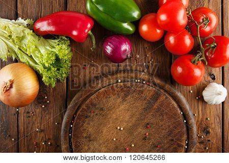 Various vegetables for pizza at wooden background