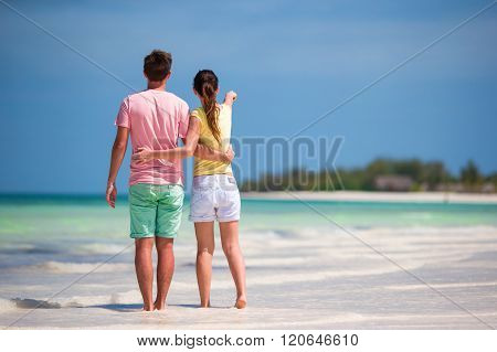 Young happy couple on white beach at tropical vacation