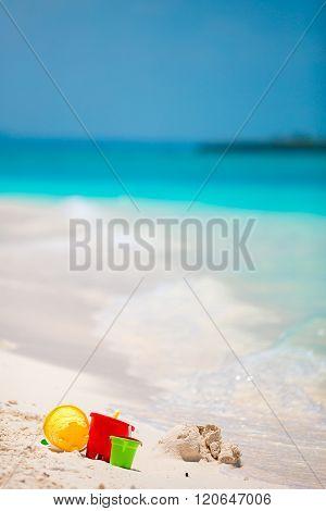Summer kid's beach toys in white sandy beach