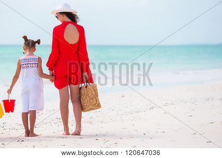 Mother and little girl during tropical vacation