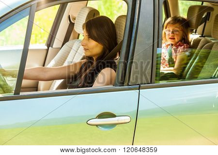 Mother And Child In Car. Vacation Trip Travel.