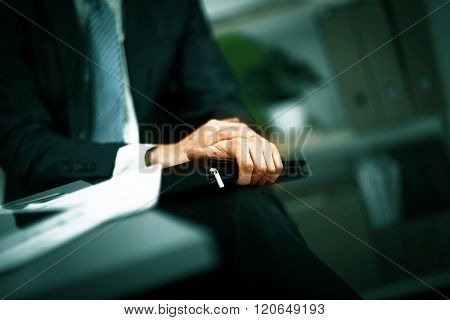 businessman with a folder in his hands in the office
