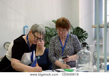 ST. PETERSBURG, RUSSIA - FEBRUARY 25, 2016: Head of the main waterworks of the city Olga Kudryavtseva (left) and Natalia Garan in the jury of the professional skills contest among chemical analyst