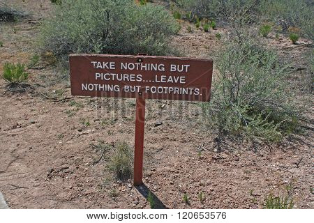 Sign stating Take Nothing But Pictures, Leave Nothing But Footprints