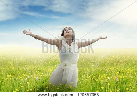 Woman Enjoying Freedom On Flower Field