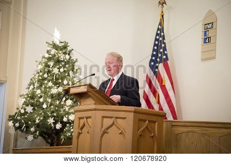 SUCCASUNNA, NJ-DEC 12, 2015: Congressman Leonard Lance of New Jerseys 7th district speaks at the memorial service in the First Presbyterian Church during the 2015 Wreaths Across America event.