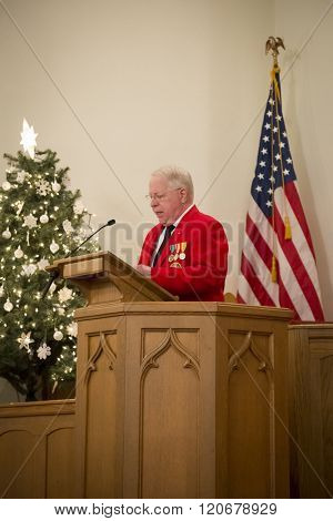 SUCCASUNNA, NJ-DEC 12, 2015: Opening remarks by Robert Beck, Commandant of L/Cpl Robert J Slattery Detachment U.S. Marine Corps League at the memorial service for 2015 Wreaths Across America event.