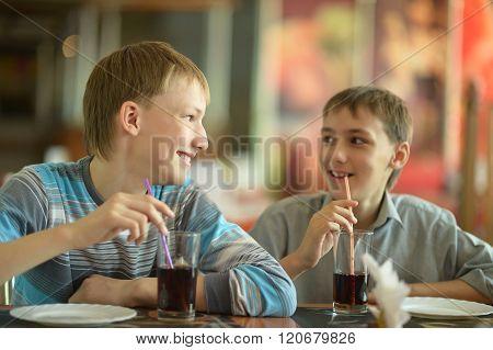 Two cute boys drinking