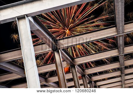I-beam steel construction, with firework at night on the sky