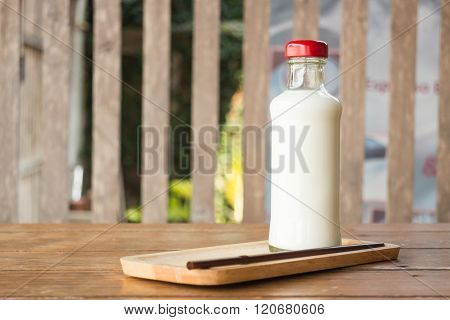 Bottle Of Milk On Wooden Table