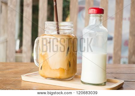 Homemade Iced Coffee Latte On Wooden Table