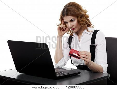 Suspicious Businesswoman With Credit Card