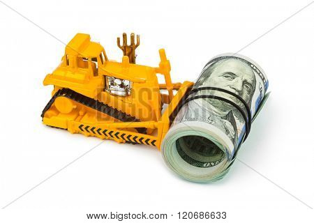 Toy bulldozer and money isolated on white background