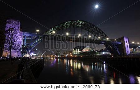The Tyne Bridge at Newcastle/Gateshead under a full moon. poster