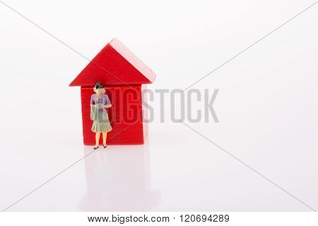 Woman Figure Nearby A House Made Of Blocks